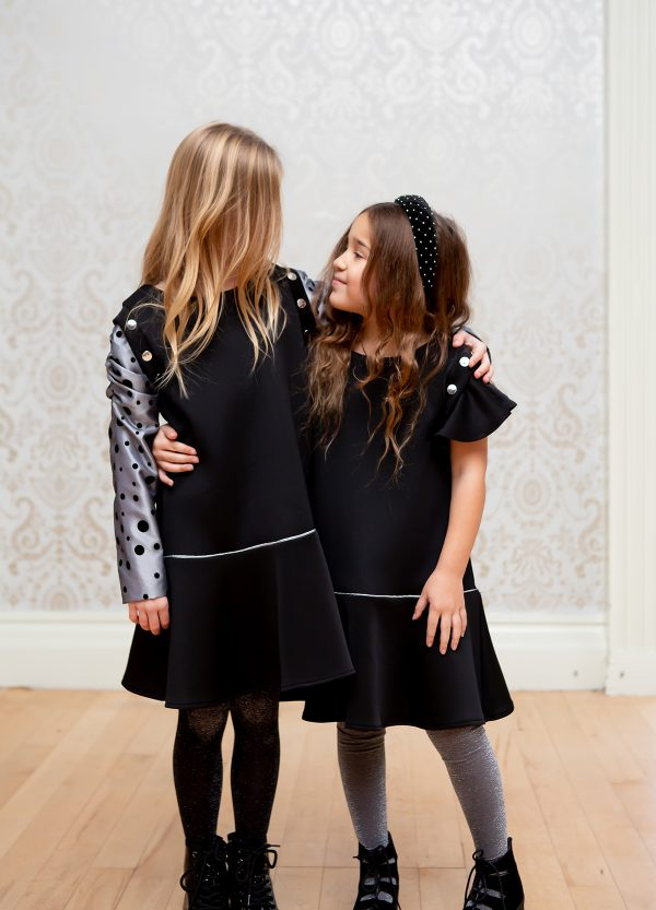 Two girls in LBD different sleeves