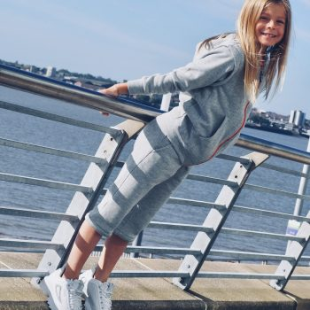 Grey tracksuit by the river